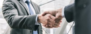 A close up of two businessmen shaking hands
