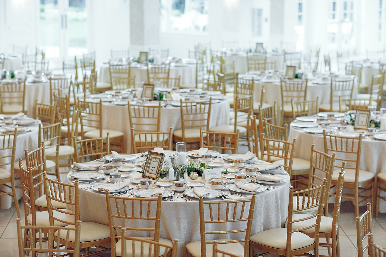 Wide shot of an events space full of tables and chairs
