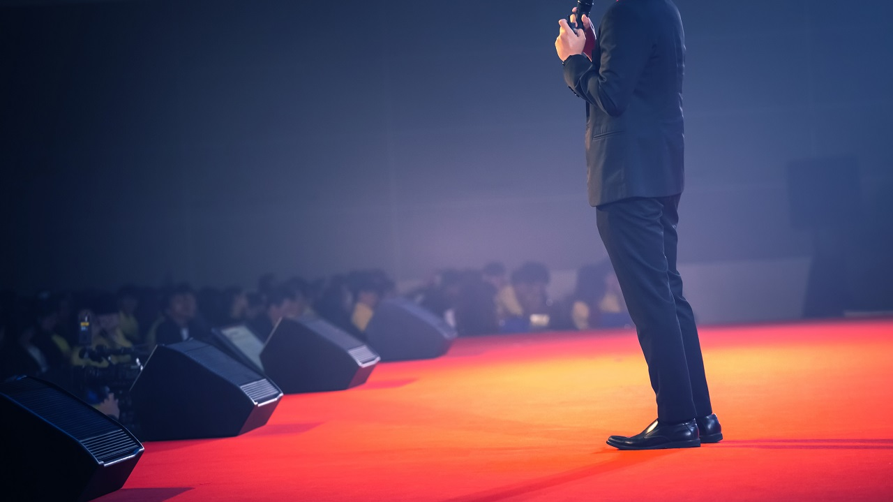 Shot of an event speaker's legs on stage