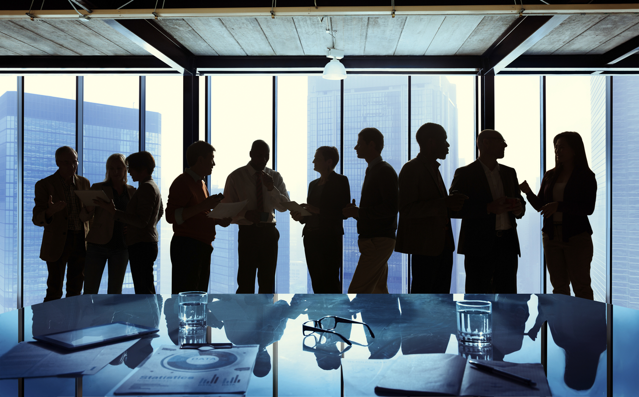 Silhouttes of business people networking