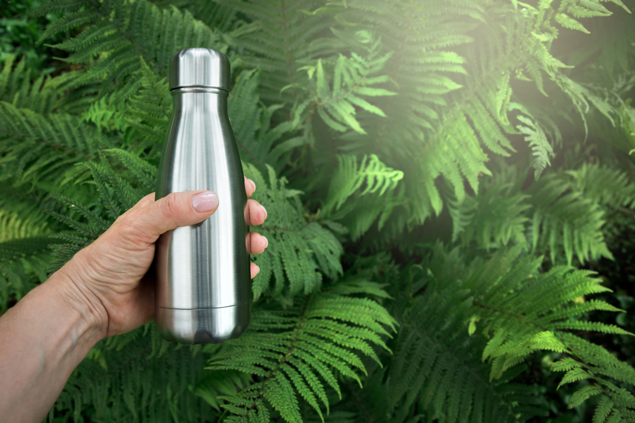A reusable metal water bottle as a giveaway