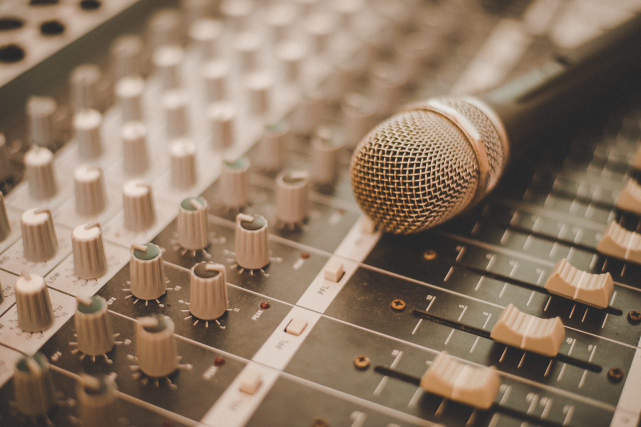 A microphone and the sound panel at a conference