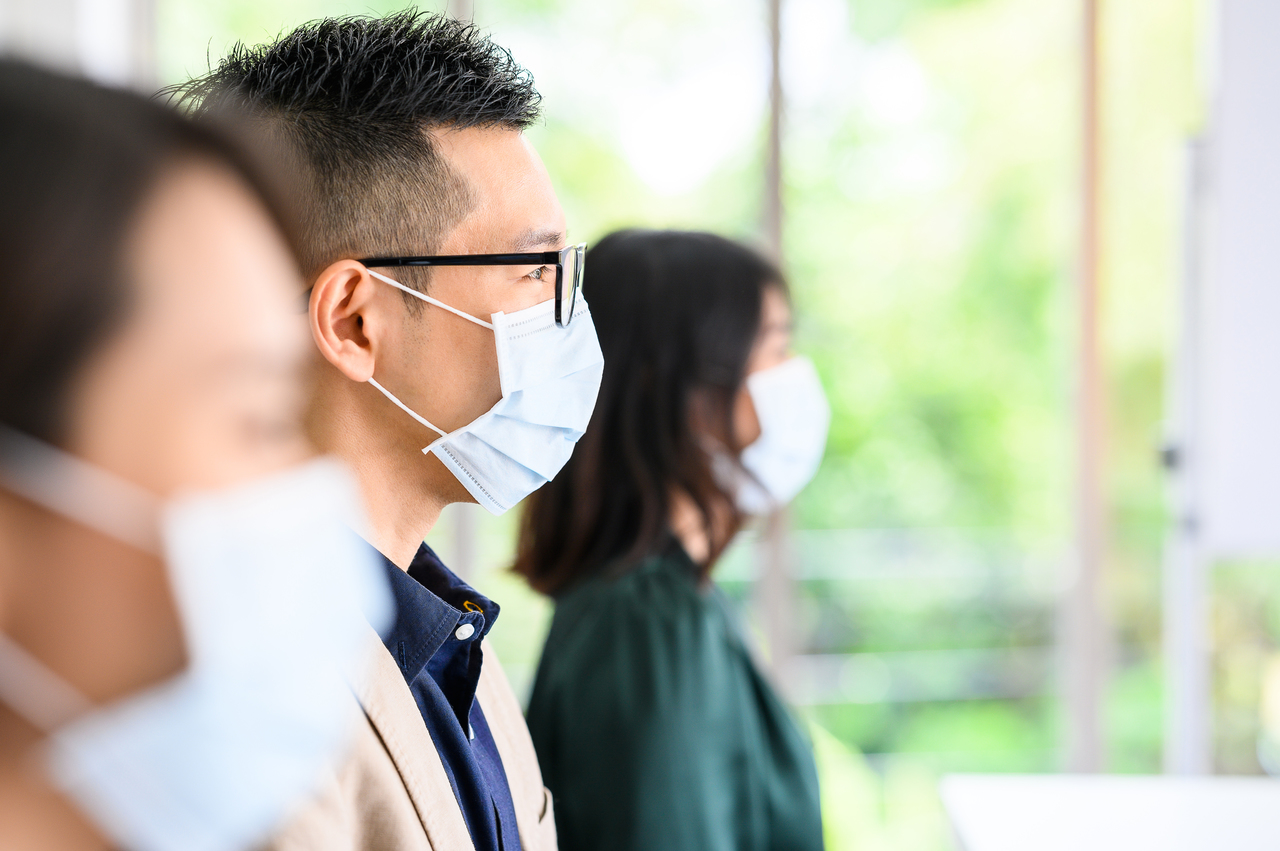 People at a meeting wearing face masks