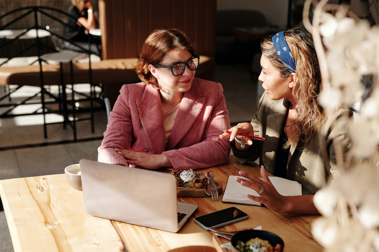 Two businesswomen in a meeting in an exhibition