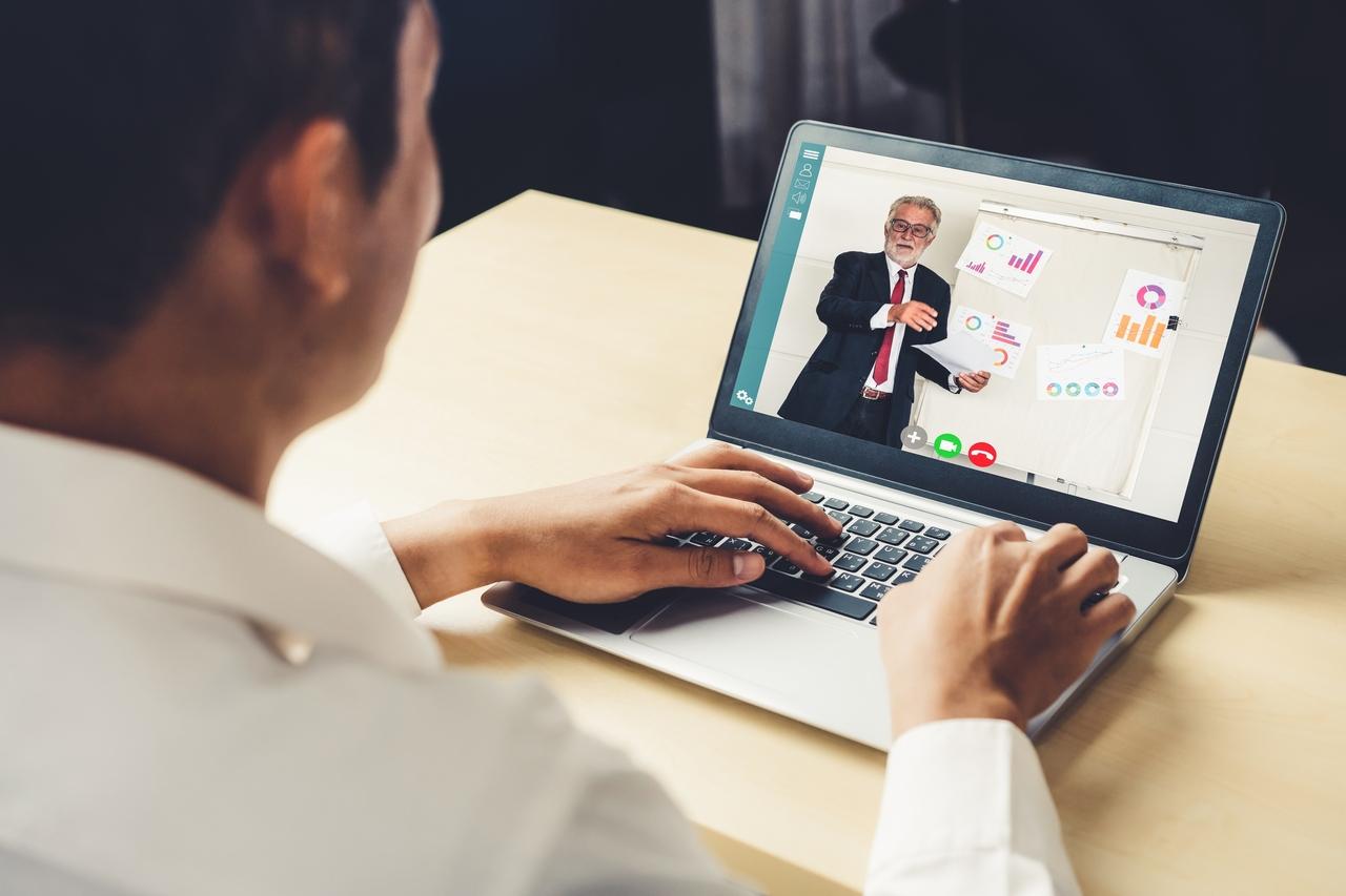 A businessman attending an online event